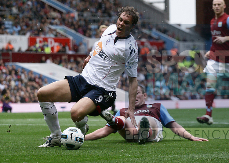 Johan Elmander of Bolton appears to be fouled by Richard Dunne of Aston Villa, but failed to earn a penalty from referee Mike Dean