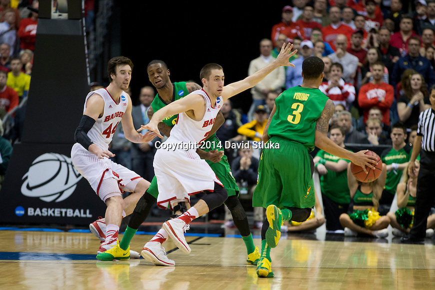Wisconsin Badgers guard Josh Gasser (21) and center Frank Kaminsky (44) play defense during the third-round game in the NCAA college basketball tournament against the Oregon Ducks Saturday, April 22, 2014 in Milwaukee. The Badgers won 85-77. (Photo by David Stluka)