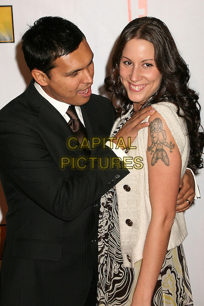ADAM BEACH & wife TARA.At The 12th Annual Broadcast Film Critics Choice Awards held at The Santa Monica Civic Auditorium in Santa Monica, California, LA, USA, January 12th 2007. .half length beech tattoo on shoulder married husband.CAP/ADM/BP.©Byron Purvis/AdMedia/Capital Pictures.