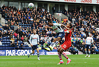 Preston North End's Daniel Johnson scores the opening goal despite the attentions of Barnsley's Toby Sibbick<br /> <br /> Photographer Kevin Barnes/CameraSport<br /> <br /> The EFL Sky Bet Championship - Preston North End v Barnsley - Saturday 5th October 2019 - Deepdale Stadium - Preston<br /> <br /> World Copyright © 2019 CameraSport. All rights reserved. 43 Linden Ave. Countesthorpe. Leicester. England. LE8 5PG - Tel: +44 (0) 116 277 4147 - admin@camerasport.com - www.camerasport.com