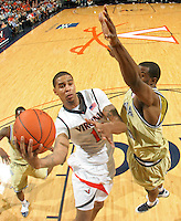 Virginia's Sylven landesberg, left, is defended by Georgia Tech's Mfon Udofia during an ACC college basketball game Wednesday Jan. 13, 2010 in Charlottesville, Va. Virginia won 82-75.  (Photo/Andrew Shurtleff)