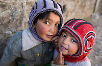 Lukla Nepal Young children pose in alley in Lukla Solukhumbu 54
