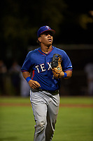 AZL Rangers first baseman Heriberto Hernandez (4) jogs off the field between innings of an Arizona League game against the AZL Dodgers Mota at Camelback Ranch on June 18, 2019 in Glendale, Arizona. AZL Dodgers Mota defeated AZL Rangers 13-4. (Zachary Lucy/Four Seam Images)