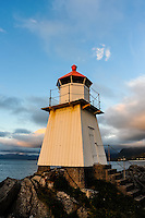 Norway, Lofoten. Hovsund on the northern part of Gimsøya. A small lighthouse at the end of the large pier.