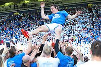 Dean Whitehead of Huddersfield Town is thrown in the air by his team mates as he retires from Professional Football after the Premier League match between Huddersfield Town and Arsenal at the John Smith's Stadium, Huddersfield, England on 13 May 2018. Photo by Thomas Gadd / PRiME Media Images.