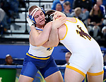BROOKINGS, SD - JANUARY 18: Alex Macki from South Dakota State University controls Sam Egan from Wyoming during their heavyweight pound match Thursday night at Frost Arena in Brookings. (Photo by Dave Eggen/Inertia)