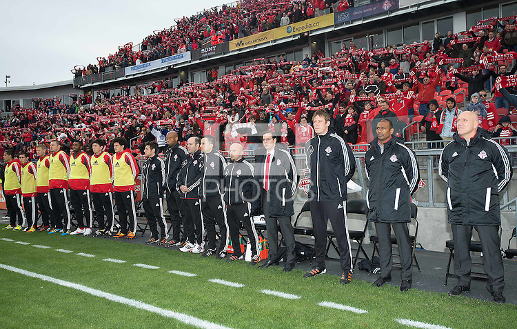 24 March 2012: The Toronto FC coaching staff and team members stand for the national anthems during the opening ceremonies in a game between the San Jose Earthquakes and Toronto FC at BMO Field in Toronto..The San Jose Earthquakes won 3-0..