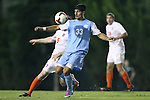 08 October 2013: North Carolina's Raby George (SWE) (33) and Clemson's Thomas McNamara (5). The University of North Carolina Tar Heels hosted the Clemson University Tigers at Fetzer Field in Chapel Hill, NC in a 2013 NCAA Division I Men's Soccer match. Clemson won the game 2-1 in overtime.