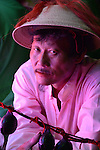 Donggang, Taiwan -- Taoist believer in the pink blinking neon lights of a sedan containing a god statue.