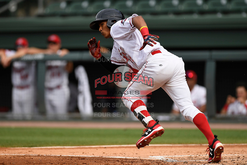 Center fielder Lorenzo Cedrola (5) of the Greenville Drive runs toward first in game one of a doubleheader against the Rome Braves on Tuesday, May 30, 2017, at Fluor Field at the West End in Greenville, South Carolina. Rome won, 10-7. (Tom Priddy/Four Seam Images)