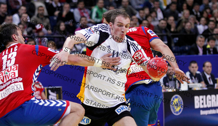 Holger Glandorf of Germany in action during main round, group 1 men`s EHF EURO 2012 championship handball game between Serbia and Germany in Belgrade, Serbia, Saturday, January 21, 2011.  (photo: Pedja Milosavljevic / thepedja@gmail.com / +381641260959)