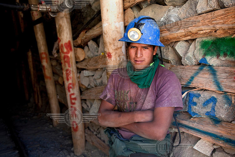 A portrait of a miner at the entrance of a gold mine in the village of Cuatro Horas in the department of Arequipa.