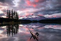 Sunrise at Two Jack Lake in Banff National Park. Mt. Rundel reflects upon Two Jack Lakes calm waters.
