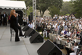 Country music singer Wynonna Judd performs during her United Service Organization (USO) Concert at the Pentagon on May 21, 2004.  Judd performed for an audience of military and Department of Defense (DoD) civilians that included military personnel recovering from wounds received in Iraq and Afghanistan. .Mandatory Credit: Helene Stikkel / DoD via CNP