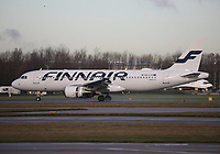 A Finnair Airbus A320-214 Registration OH-LXD at Manchester Airport on 11.2.19 arriving from Helsinki Vantaa Airport, Finland.