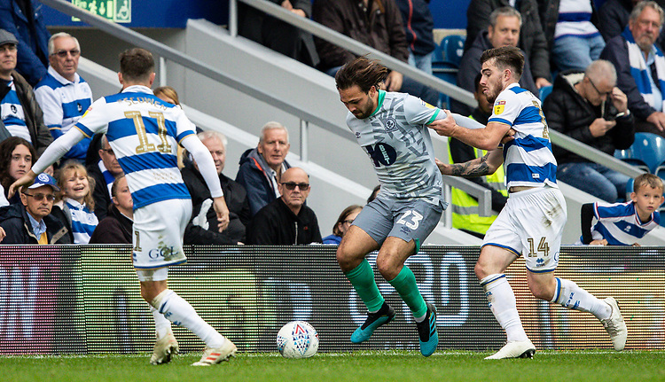 Blackburn Rovers' Bradley Dack (centre) competing with Queens Park Rangers' Ryan Manning (right) <br /> <br /> Photographer Andrew Kearns/CameraSport<br /> <br /> The EFL Sky Bet Championship - Queens Park Rangers v Blackburn Rovers - Saturday 5th October 2019 - Loftus Road - London<br /> <br /> World Copyright © 2019 CameraSport. All rights reserved. 43 Linden Ave. Countesthorpe. Leicester. England. LE8 5PG - Tel: +44 (0) 116 277 4147 - admin@camerasport.com - www.camerasport.com