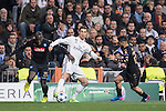Cristiano Ronaldo of Real Madrid (in white) fights for the ball with Kalidou Koulibaly of SSC Napoli and teammate Lorenzo Insigne (in black) during the match Real Madrid vs Napoli, part of the 2016-17 UEFA Champions League Round of 16 at the Santiago Bernabeu Stadium on 15 February 2017 in Madrid, Spain. Photo by Diego Gonzalez Souto / Power Sport Images
