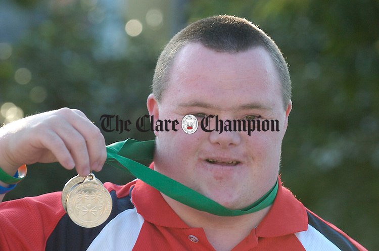 Miltown Malbay man Sean Nestor proudly displays his table tennis medals at the celebration homecoming night in Woodstock hotel for Clare participants in the Natonal Special Olympics. Photograph by John Kelly.