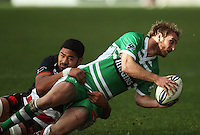 Manawatu fullback Casey Stone looks for support in the tackle during the Air NZ Cup rugby match between Manawatu Turbos and Counties-Manukau Steelers at FMG Stadium, Palmerston North, New Zealand on Sunday, 2 August 2009. Photo: Dave Lintott / lintottphoto.co.nz