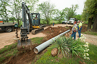 NWA Democrat-Gazette/BEN GOFF @NWABENGOFF<br /> A crew from the Benton County Road Department replaces drainage culverts Thursday, May 10, 2018, along Accident Road near Springdale.