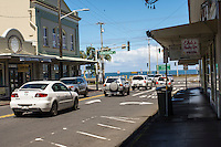On a sunny day, cars head makai (toward the ocean) at the intersection of Kamehameha and Waianuenue Avenues in Hilo, Big Island of Hawai'i.