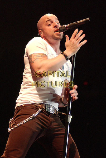 """CHRIS DAUGHTRY .who is the lead vocalist of DAUGHTRY and American Idol finalist performs as opening act for Bon Jovi's """"Lost Highway Tour 2008"""" held at the Mellon Arena,.Pittsburgh, Pennsylvania, USA,.05 March 2008..half length music concert gig on stage microphone .CAP/ADM/JNL.?Jason L Nelson/Admedia/Capital Pictures"""