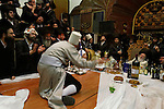 Israel, Bnei Brak, the Rabbi of Premishlan congregation and his hasids rejoice the holiday of Purim with singing, dancing and wine at the Synagogue