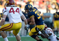 Jonah Hodges of California runs the ball during NCAA football game against USC at Memorial Stadium in Berkeley, California on November 9th, 2013.   USC defeated California, 62-28.