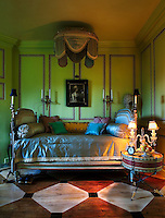 A French daybed in a wood-panelled room with the floor painted to resemble marquetry