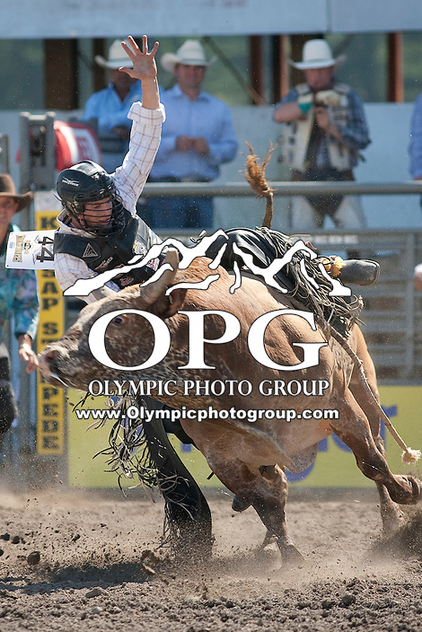 28 Aug 2011: Riker Carter riding the bull Cowboy Caviar was not able to score during the first round of the Seminole Hard Rock Extreme Bulls competition at the Kitsap County Stampede in Bremerton, Washington.