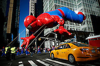 USA, New York, Nov 28, 2013. The Spiderman balloon floats while people take part in the 87th Macy's Thanksgiving Day Parade in New York City. Photo by VIEWpress/Eduardo Munoz Alvarez