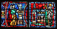 Fulbert supervising the building of the new cathedral after the fire of 1020 (left) and Fulbert in front of the completed cathedral (right) (this is an imagined scene as Fulbert died in 1028, 9 years before the completion of the rebuilding), from the Life of Fulbert stained glass window, in the south transept of Chartres Cathedral, Eure-et-Loir, France. This window replaces the original 13th century window depicting the Life of St Blaise, which was destroyed in 1791. It was created in 1954 by Francois Lorin as a gift of the Institute of American Architects, on a theme chosen by the Canon Yves Delaporte. It depicts the life of Fulbert, bishop of Chartres in the 11th century. Chartres cathedral was built 1194-1250 and is a fine example of Gothic architecture. Most of its windows date from 1205-40 although a few earlier 12th century examples are also intact. It was declared a UNESCO World Heritage Site in 1979. Picture by Manuel Cohen