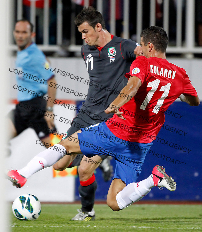 NOVI SAD, SERBIA - SEPTEMBER 11: Gareth Bale (L) of Wales try to shoot near Aleksandar Kolarov (R)  of Serbia during the FIFA 2014 World Cup Qualifier at stadium Karadjordje Park between Serbia and Wales on September 11, 2012 in Novi Sad, Serbia (Photo by Srdjan Stevanovic//Getty Images)