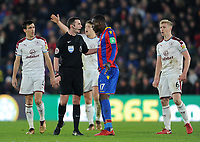 Todays match referee Michael Oliver speaks to Crystal Palace's Christian Benteke<br /> <br /> Photographer Ashley Crowden/CameraSport<br /> <br /> The Premier League - Crystal Palace v Burnley - Saturday 13th January 2018 - Selhurst Park - London<br /> <br /> World Copyright &copy; 2018 CameraSport. All rights reserved. 43 Linden Ave. Countesthorpe. Leicester. England. LE8 5PG - Tel: +44 (0) 116 277 4147 - admin@camerasport.com - www.camerasport.com