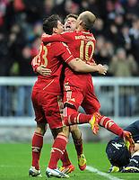 FUSSBALL   1. BUNDESLIGA  SAISON 2011/2012   17. Spieltag FC Bayern Muenchen - 1. FC Koeln       16.12.2011 Jubel nach dem Tor zum 1:0 Mario Gomez, Thomas Mueller, Arjen Robben (v. li., FC Bayern Muenchen)
