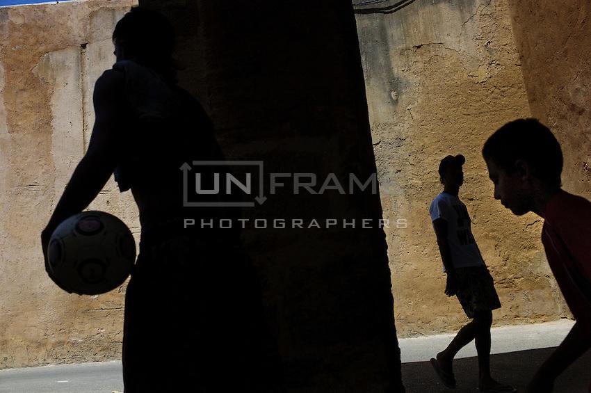 Children on theri way to the beach through the Medina in Rabat