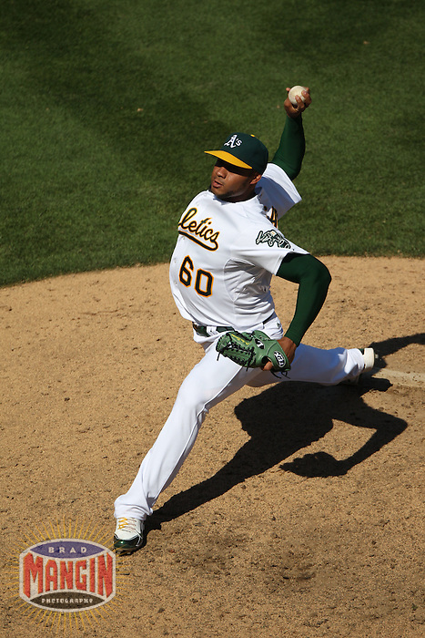 OAKLAND, CA - SEPTEMBER 7:  Fautino De Los Santos #60 of the Oakland Athletics pitches against the Kansas City Royals during the game at O.co Coliseum on September 7, 2011 in Oakland, California. Photo by Brad Mangin