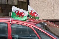 STORY BY STEVEN MORRIS SWANSEA, UK. 5th July 2015. Welsh flags fly from a car in Mayhill, the area of Swansea that Wales manager Chris Coleman comes from.