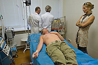 Odinitsovo, Russia, 26/06/2007..German heroin addict Christian Rambow hallucinates under treatment at Doctor Zobin's Medical Centre For Drug And Alcohol Dependence. The centre, which uses radical therapy developed by the former military doctor to treat Russian soldiers who became addicted in Afghanistan, claims an 85% success rate in curing heroin addiction. Christian is accompanied by Nicole Gyr, who was herself cured at the centre, and now organises visits for other addicts seeking treatment.