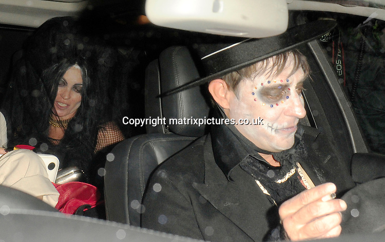 NON EXCLUSIVE PICTURE: MATRIXPICTURES.CO.UK<br /> PLEASE CREDIT ALL USES<br /> <br /> WORLD RIGHTS<br /> <br /> English model Kate Moss and her husband, &quot;The Kills&quot; rock musician Jamie Hince, attending Jonathan Ross' annual Halloween party at his North London home.<br /> <br /> The couple honour Mexico's &quot;Day Of The Dead&quot; in matching skeleton fancy dress costumes.<br /> <br /> OCTOBER 31st 2013<br /> <br /> REF: ASI 137101