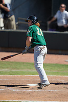 Clint Frazier (20) of the Lynchburg Hillcats watches the flight of his solo home run in the top of the eighth inning against the Winston-Salem Dash at BB&T Ballpark on August 2, 2015 in Winston-Salem, North Carolina.  The Hillcats defeated the Dash 8-3.  (Brian Westerholt/Four Seam Images)