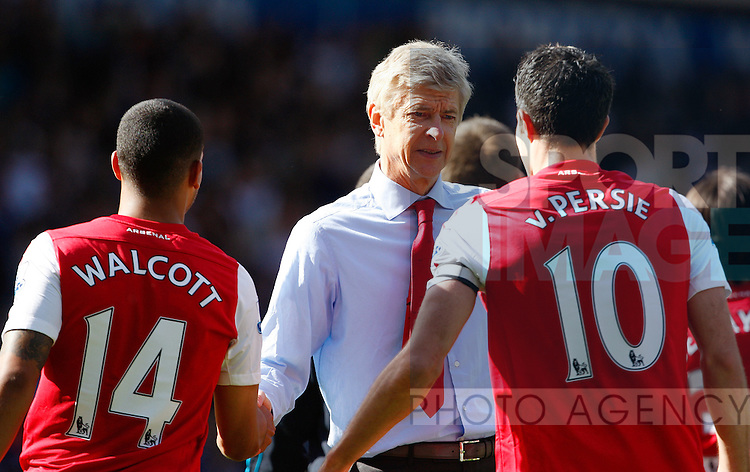 Arsenal's Robin van Persie and Arsenal's Theo Walcott  with Arsenal's Manager Arsene Wenger ..Barclays Premier League match between West Bromwich Albion v Arsenal at the Hawthorns Stadium, West Bromwich on the 13th May 2012. Pic Paul Bradbury/SPORTIMAGE...