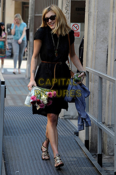 FEARNE COTTON.Leaving BBC Radio 1, London, England, UK, April 20th 2011..full length black shirt dress brown belt bag tan sandals sunglasses bunch of flowers roses pink bouquet smiling edamame beans .CAP/IA.©Ian Allis/Capital Pictures.
