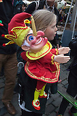 Covent Garden, London, UK. 11 May 2014. The festival starts with a procession around the streets of Covent Garden. A little girl carries a Mr Punch puppet. The Covent Garden May Fayre and Puppet Festival takes place at St Paul's Church.