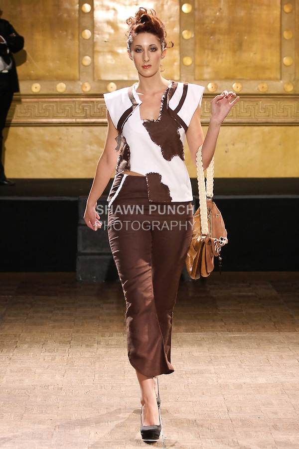 Model walks runway in an outfit by Mialy Seheno, during the Slovak Fashion Night fashion show, May 13, 2011.