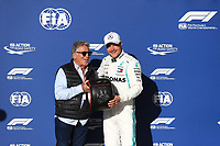 2nd November 2019; Circuit of the Americas, Austin, Texas, United States of America; Formula 1 United Sates Grand Prix, qualifying day; Mercedes AMG Petronas Motorsport, Valtteri Bottas finishes in pole and receives the Pirelli Pole Position Award from the Pirelli Representative, 1978 F1 World Champion Mario Andretti - Editorial Use