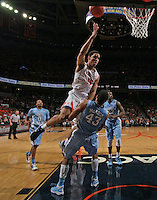 Virginia guard Malcolm Brogdon (15) shoots over North Carolina forward James Michael McAdoo (43) during an NCAA basketball game against Virginia Monday Jan. 20, 2014 in Charlottesville, VA. Virginia defeated North Carolina 76-61.