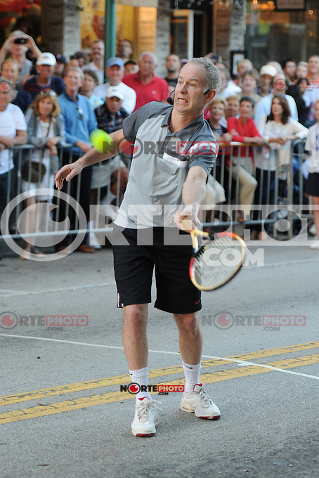 "Tennis legends John McEnroe and Mats Wilander play at the annual ""Tennis on The Avenue"" on Atlantic Avenue in Delray Beach, Florida. February 18, 2011 in Delray Beach, Florida. © MediaPunch Inc. / MPI04"