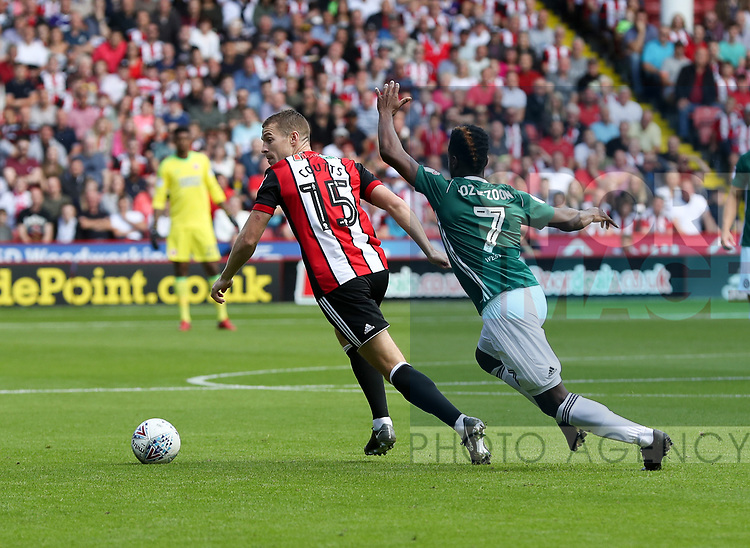 Paul Coutts of Sheffield Utd in action with Florian Jozefzoon of Brentford during the English championship league match at Bramall Lane Stadium, Sheffield. Picture date 5th August 2017. Picture credit should read: Jamie Tyerman/Sportimage