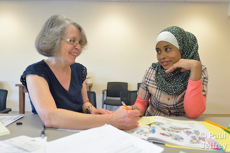 Hayat Husen (right), a newly arrived refugee, is tutored by Shirley Kurtz in a cultural orientation class in a United Methodist Church in Harrisonburg, Virginia. Husen was resettled in the Harrisonburg area by Church World Service, which also sponsors the class.<br /> <br /> Photo by Paul Jeffrey for Church World Service.